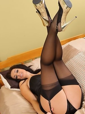 """Tiffany White looks stunning in her tight black corset top and satin miniskirt."""